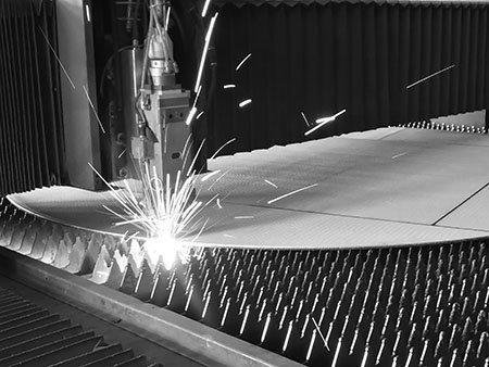 Laser cutting of 2.0m diameter sintered metal mesh filter disc on a laser cutting platform