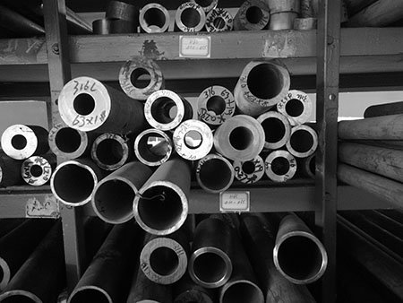 Round tubes and bars on the shelf for making end fitting of metal filter elements