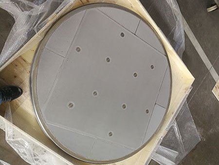 Monoblock type of sintered metal mesh filter disc plate for nutche filter, one foot for size comparison