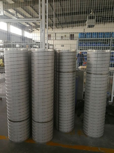 Several sintered metal mesh filter tube & screen for automatic self-cleaning filter standing outside Lianda filter's warehouse