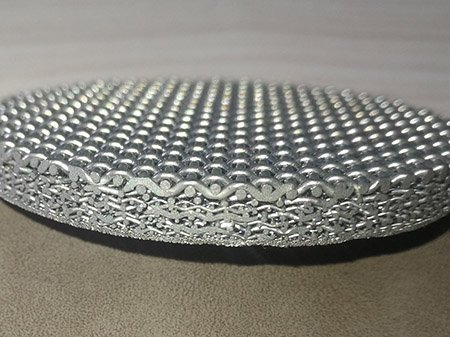 Side view of a multi-layer sintered wire mesh disc