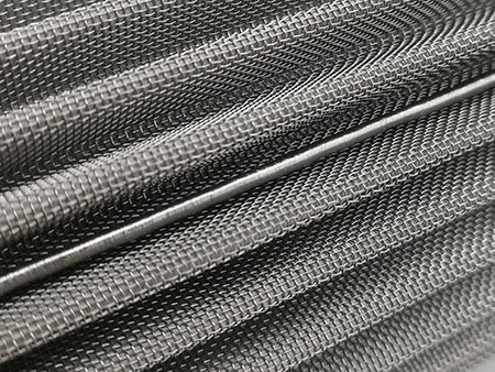 TIG welding seam of pleated mesh filter cartridge, in the middle of the mesh pleats