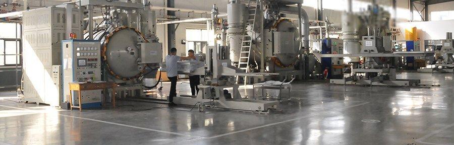 Wire mesh sintering furnace in lianda filter workshop, worker talking near the furnace control panel